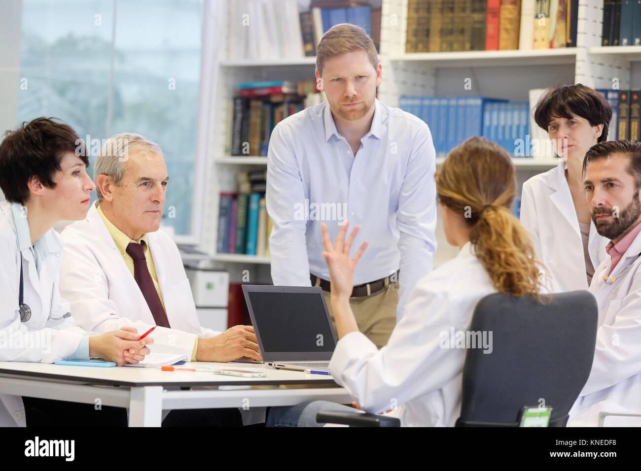 Salesman at doctors´ meeting, clinical session, Hospital, Donostia, San Sebastian, Gipuzkoa, Basque Country, - Stock Image