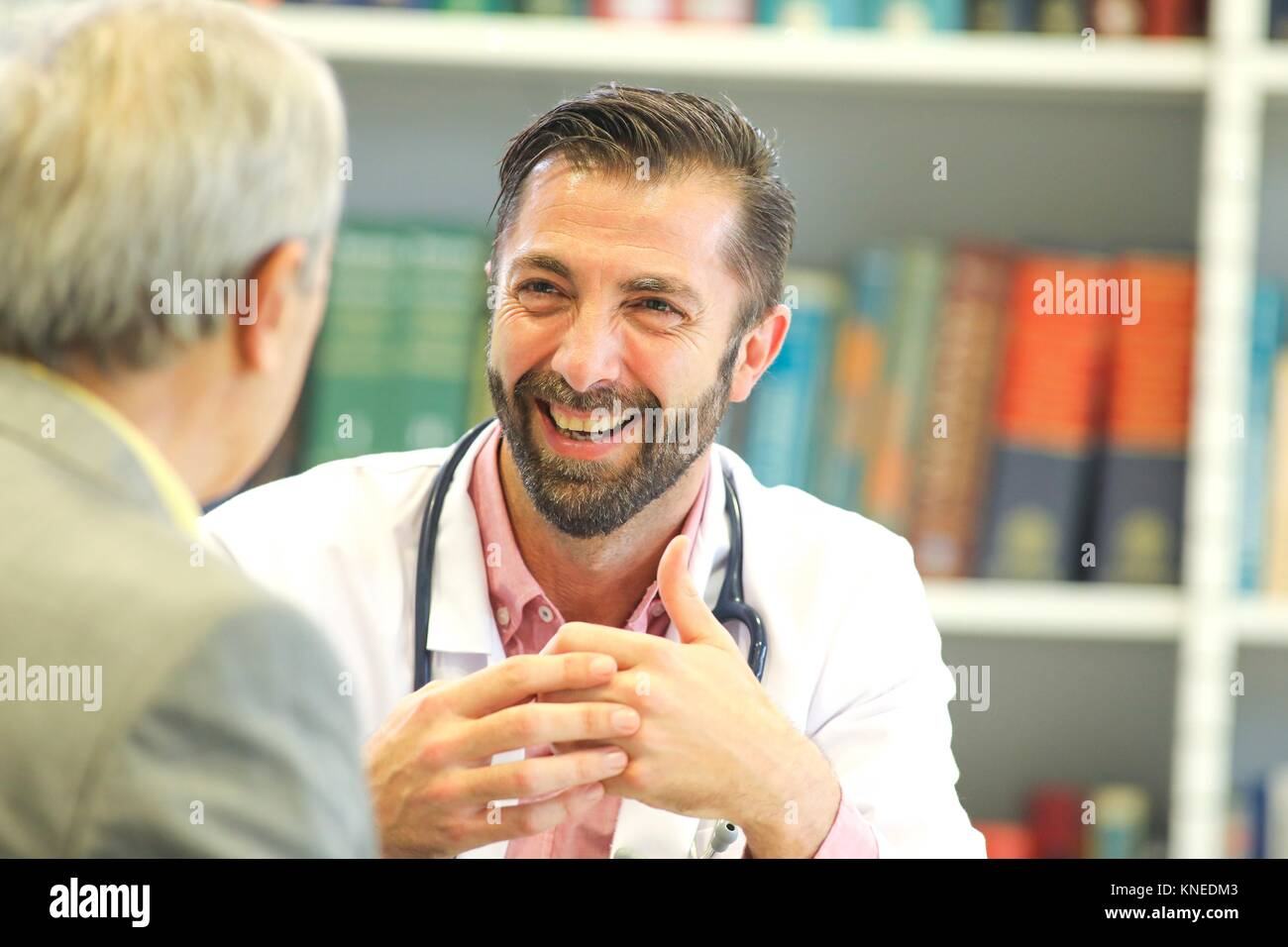 Doctor with patient, Hospital, Donostia, San Sebastian, Gipuzkoa, Basque Country, Spain - Stock Image