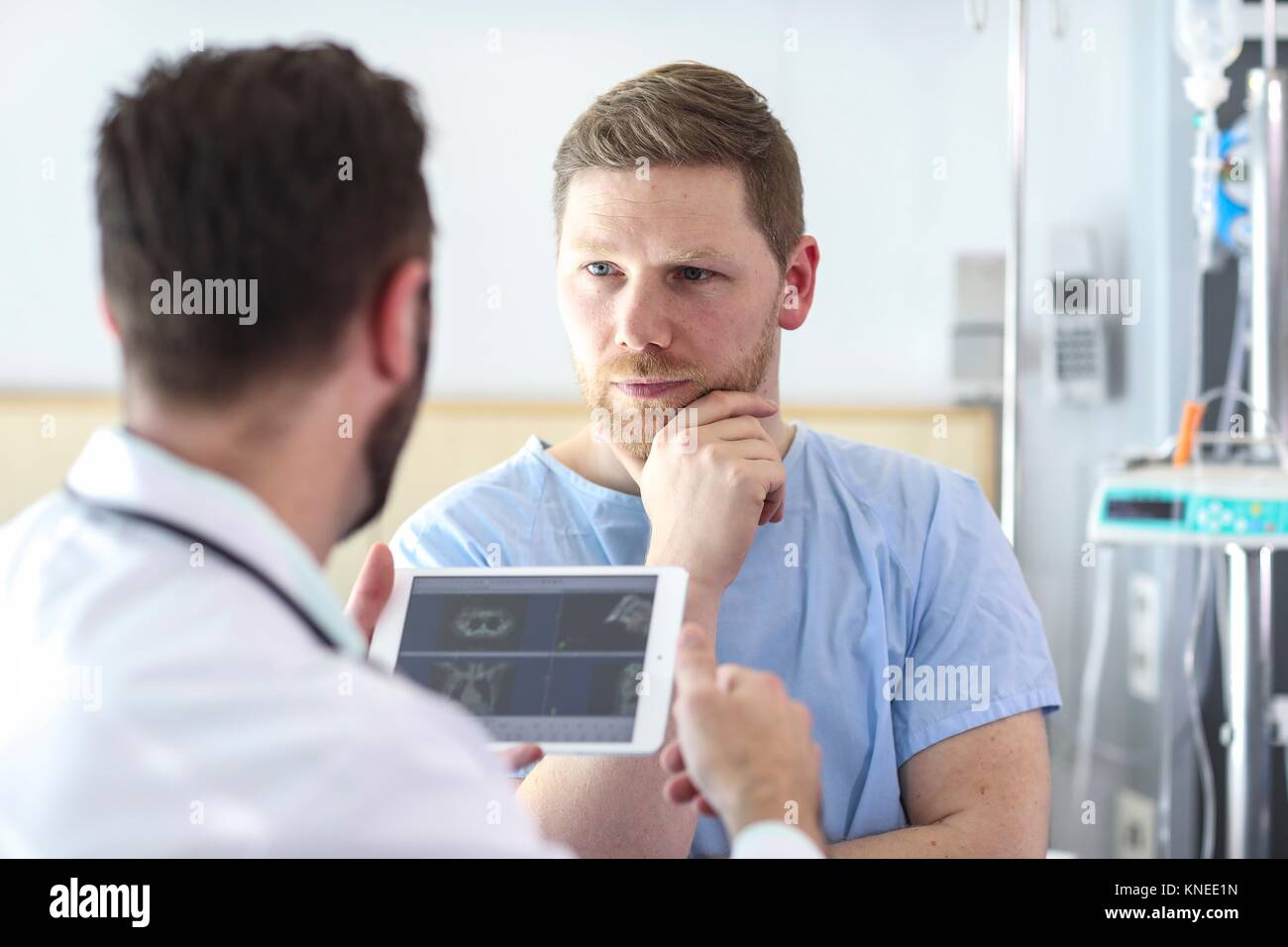 Patient in hospital room attended by a doctor, Tablet, Hospital - Stock Image
