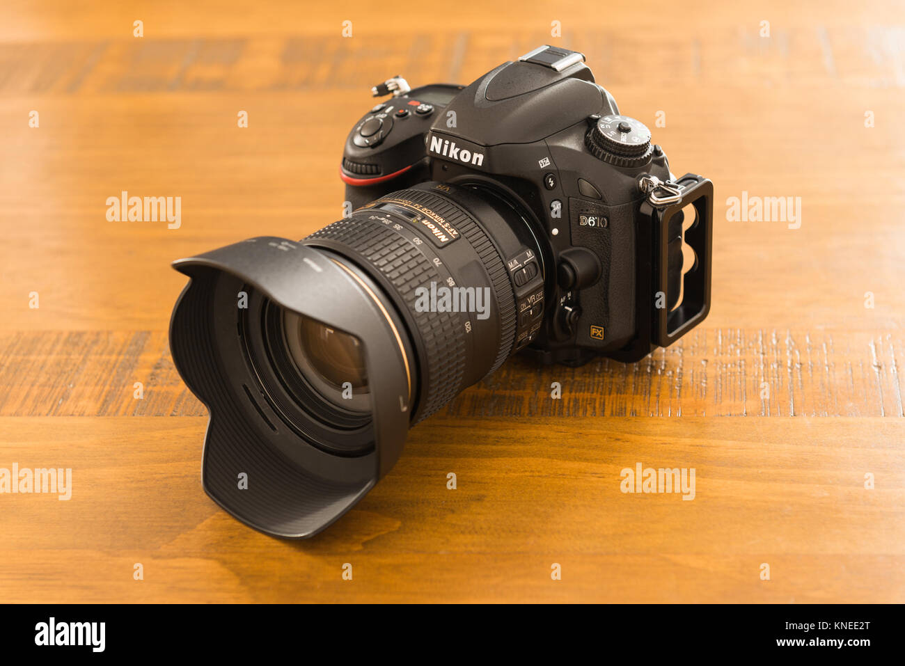 Largs,Scotland,UK-December 01, 2017: Nikon D610 Camera with 24-120mm F4 lens sitting on wooden oak table taken in - Stock Image