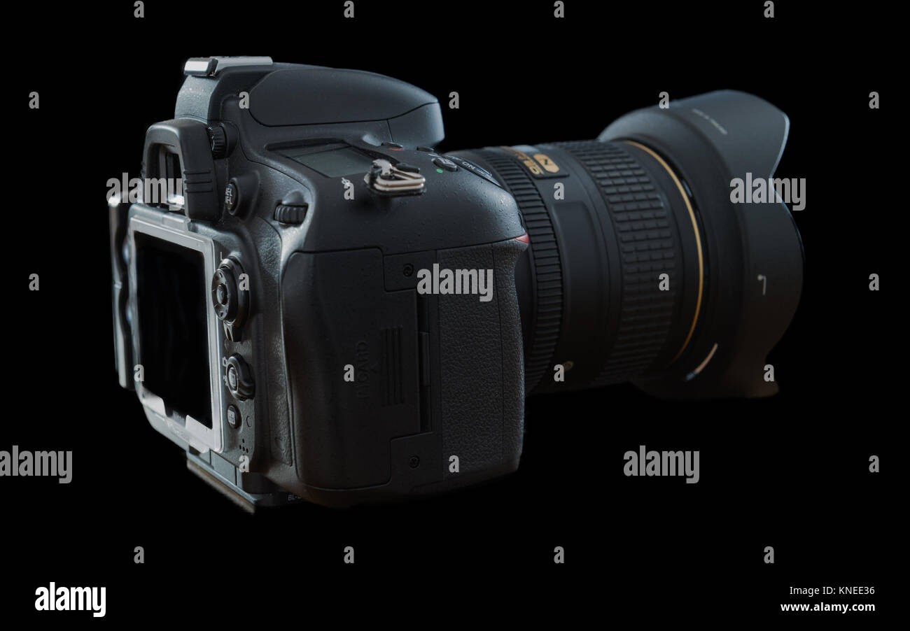 Largs,Scotland,UK-December 01, 2017: Nikon D610 Camera with 24-120mm F4 lens at a side profile and isolated on black - Stock Image