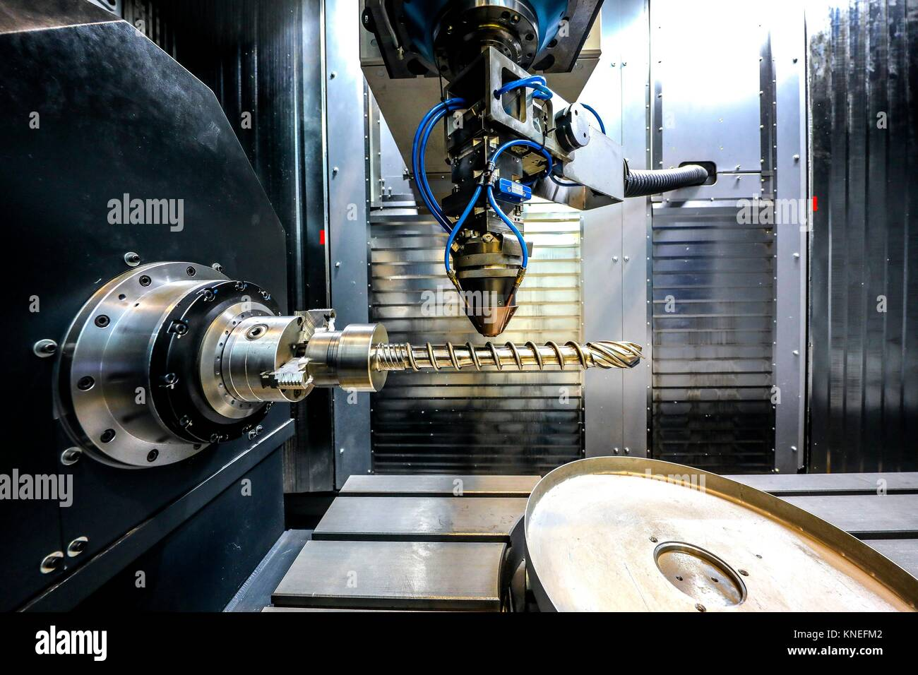 Researcher working on 3D printing machine for the industry, it allows to create large metal parts from scratch and - Stock Image