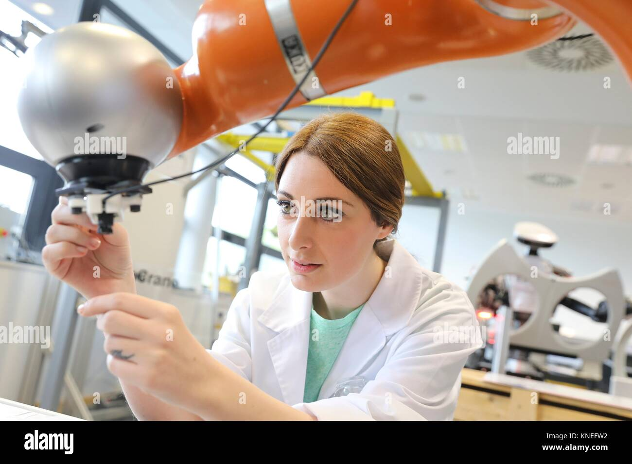 Collaborative robot for industrial assembly, LWR robot, using haptic teleoperation with force feedback Safety in - Stock Image