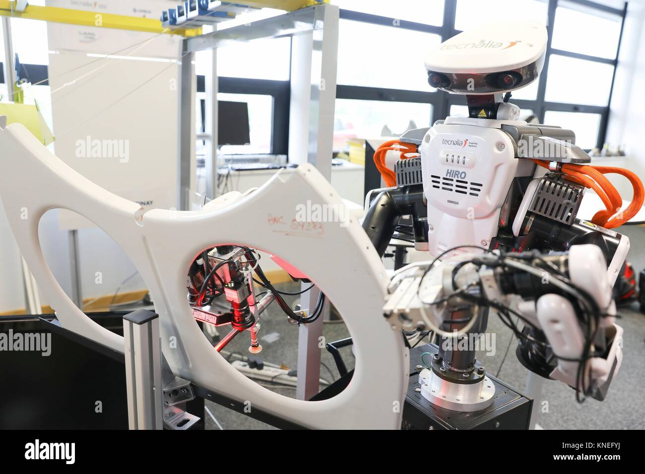 Robot with two arms for flexible robotics. Humanoid robot for automotive assembly tasks in collaboration with people, - Stock Image