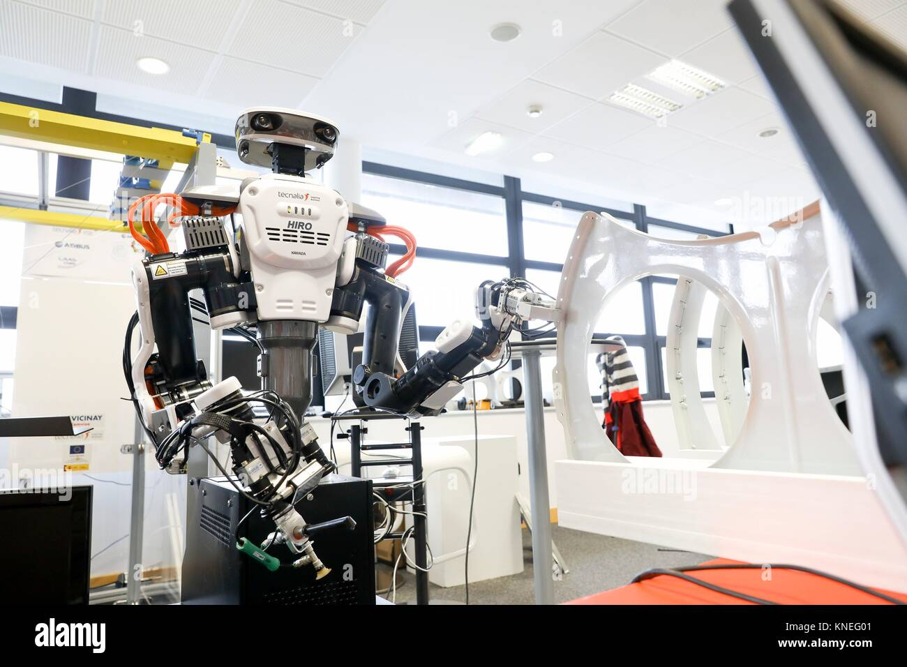 Robot with two arms for flexible robotics. Humanoid robot for automotive assembly tasks in collaboration with people, Stock Photo