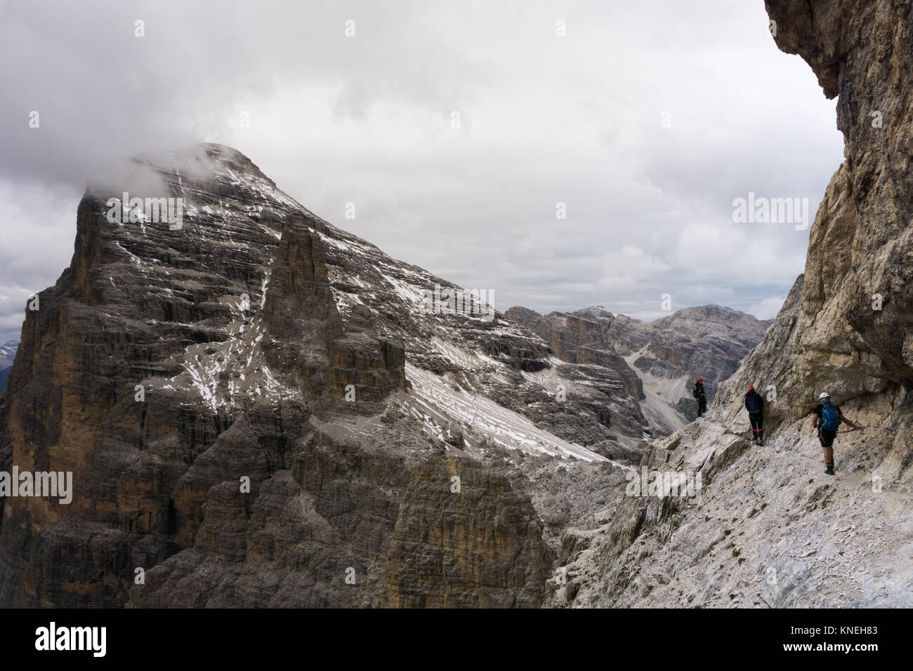 mountain climbers on an exposed Via Ferrata in the South Tyrol in the Italian Dolomites - Stock Image