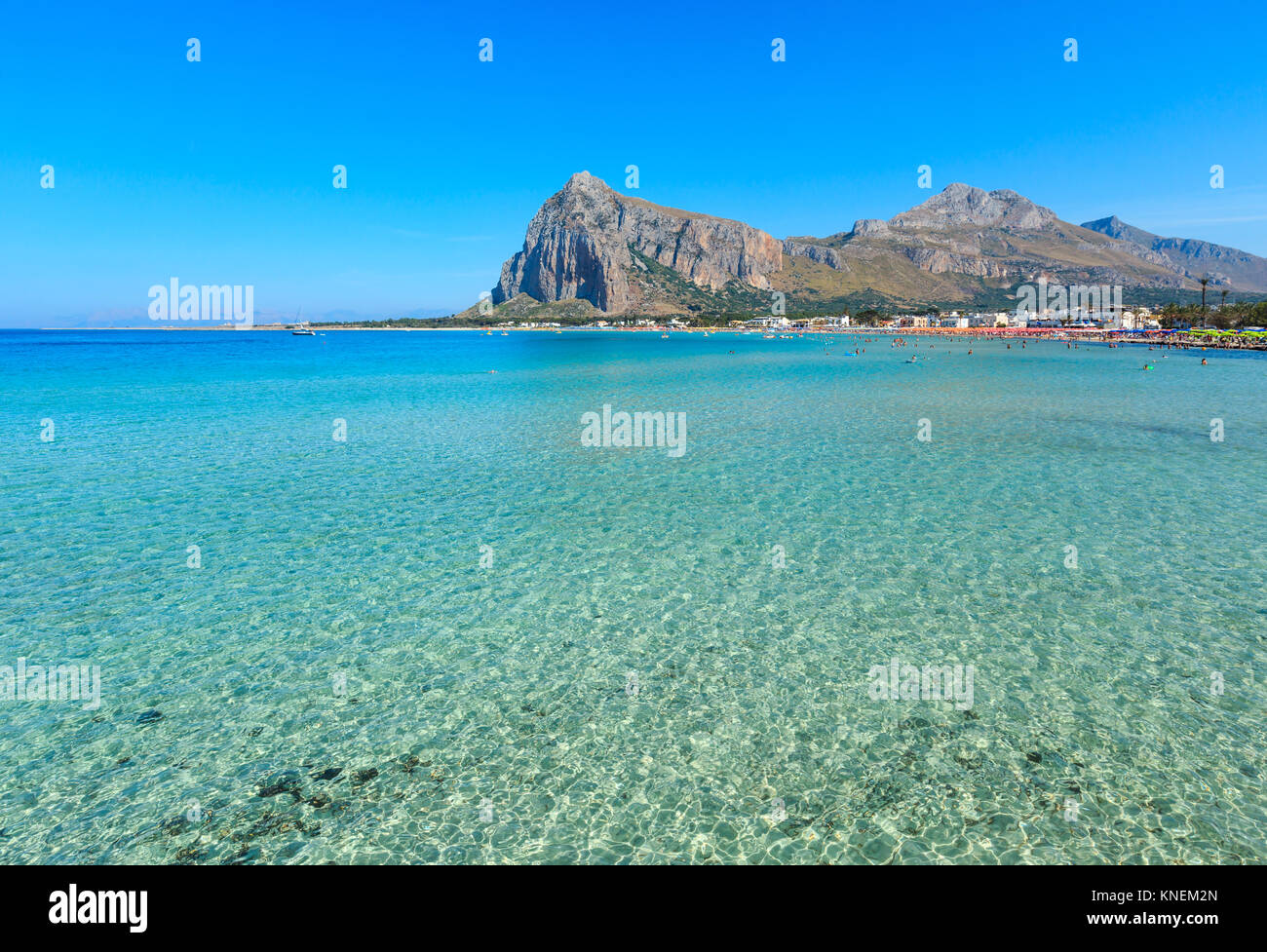 Paradise Tyrrhenian sea bay, San Vito lo Capo beach with clear azure water and extremally white sand, and Monte - Stock Image