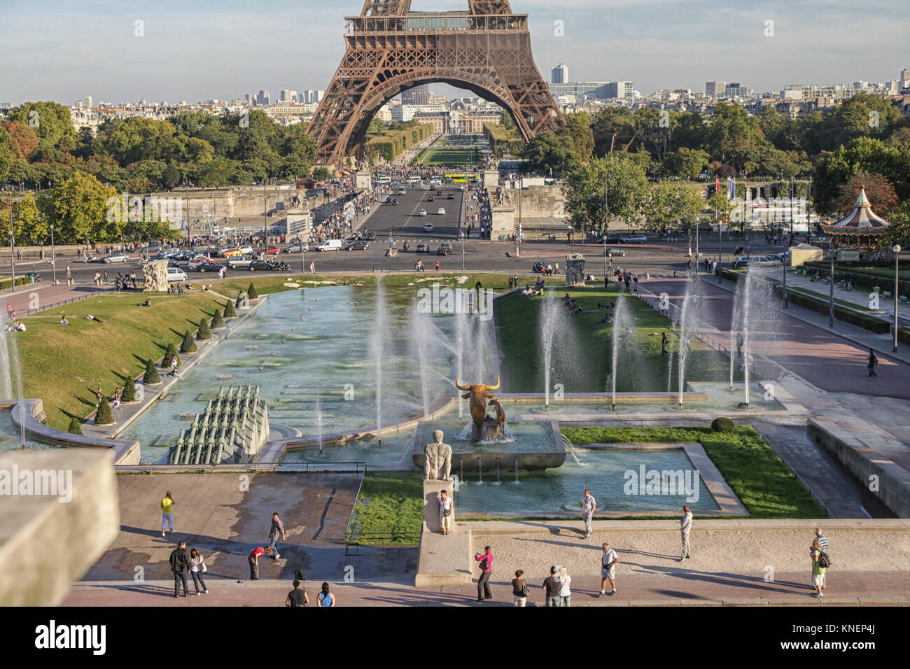 Eiffel tower in Paris, France seen from palais de Chaillot with tourists taking pictures - Stock Image