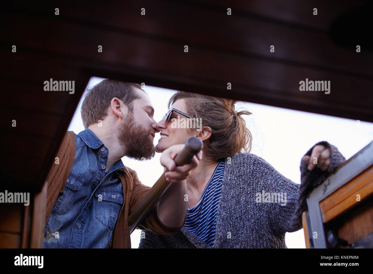 Couple steering canal boat - Stock Image