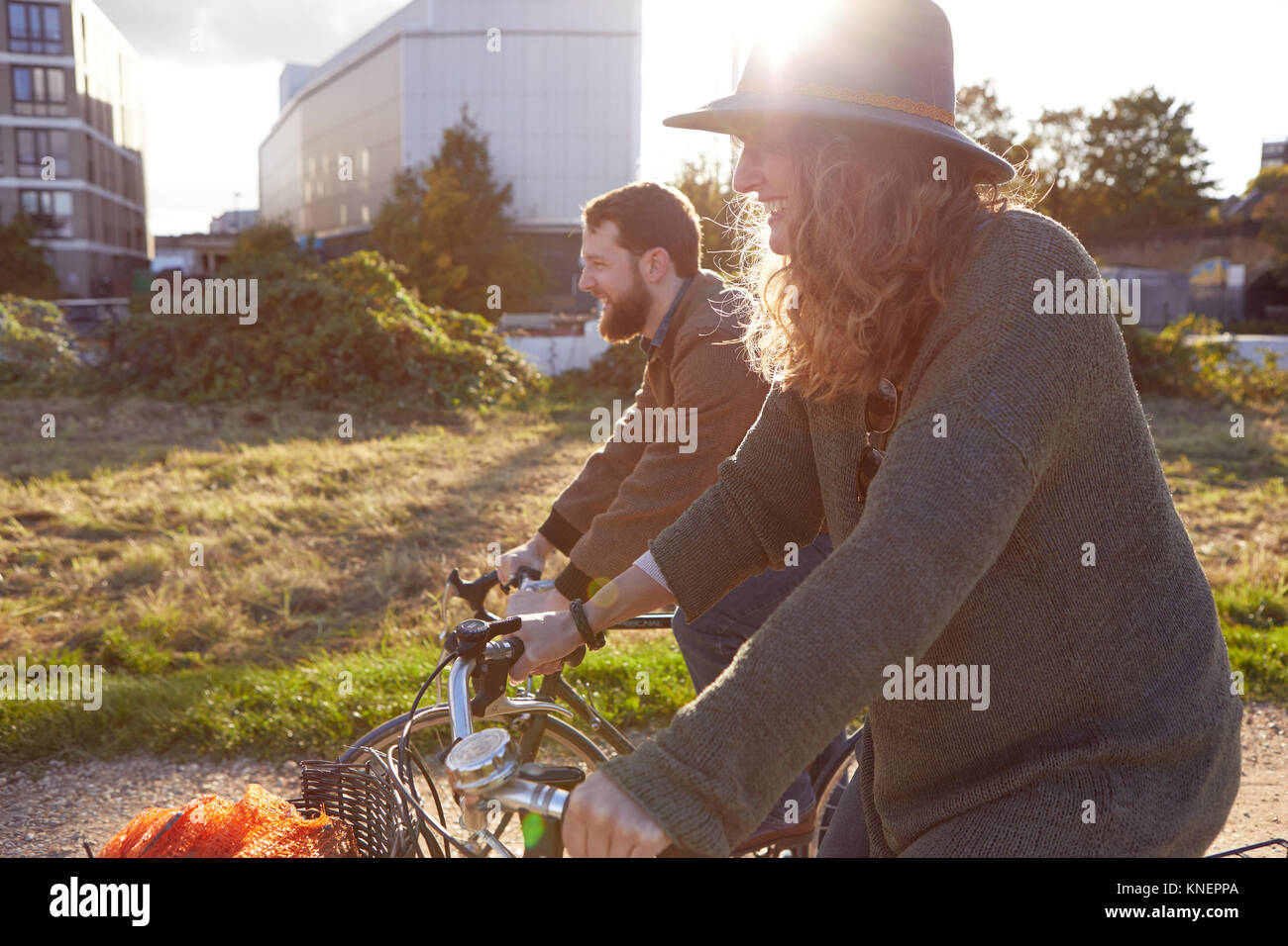 Couple enjoying cycling on marshes - Stock Image