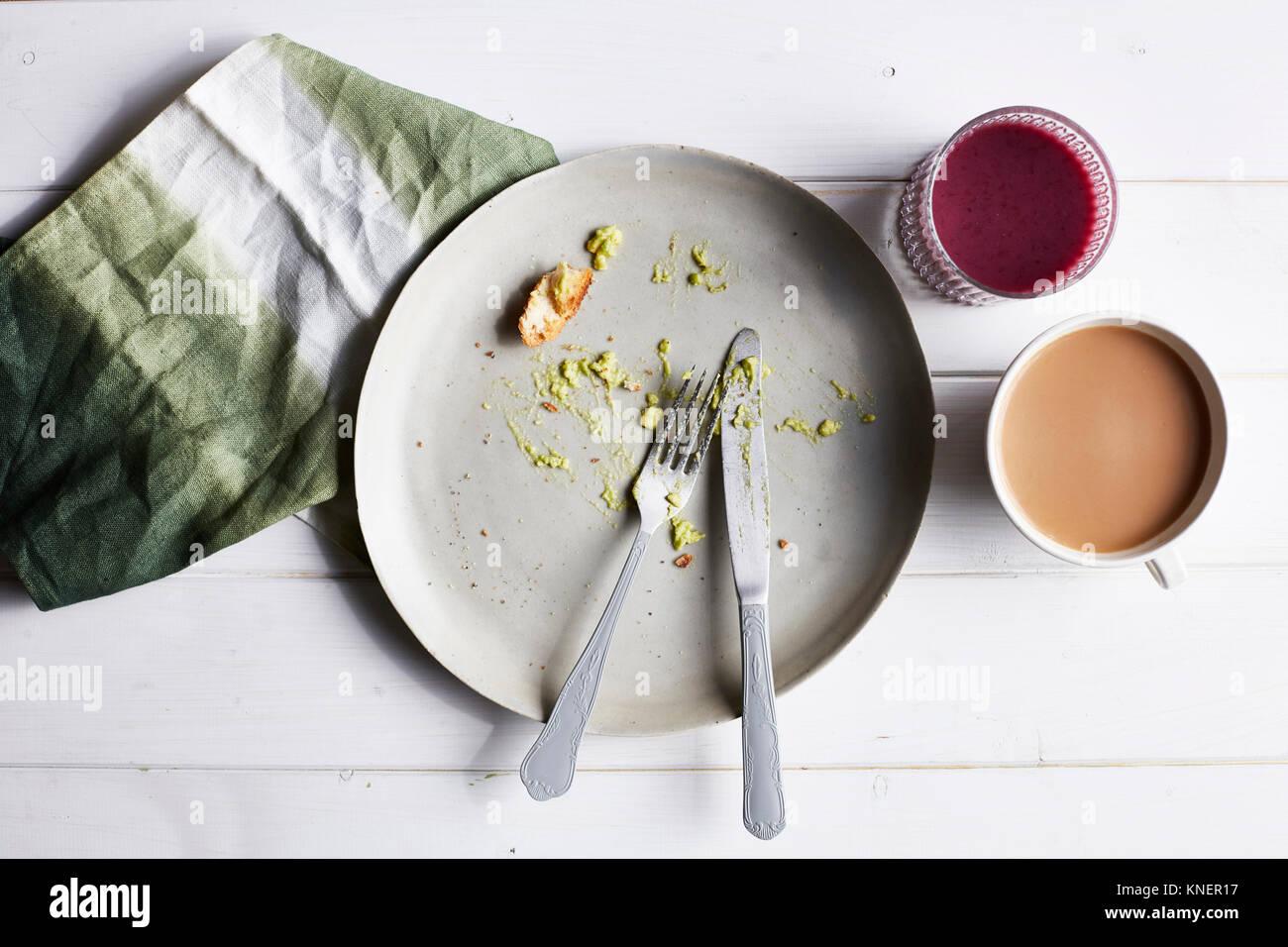 Eaten avocado meal, overhead view - Stock Image