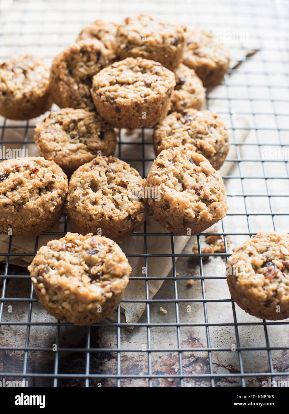 Gluten free, multi-grain cookies on cooling rack, close-up - Stock Image