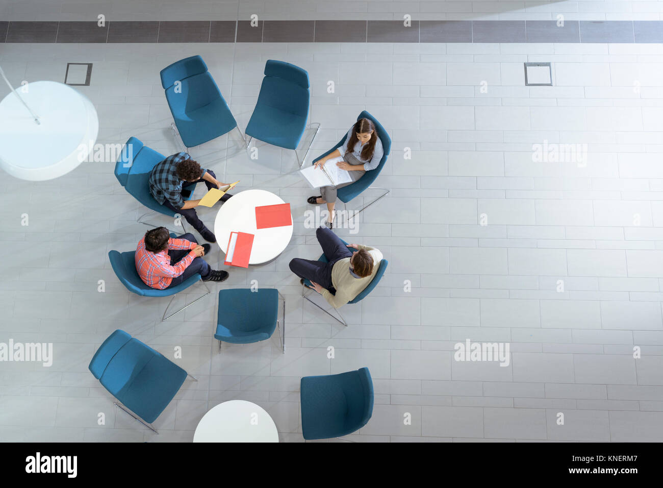 Overhead view of meeting in engineering facility - Stock Image