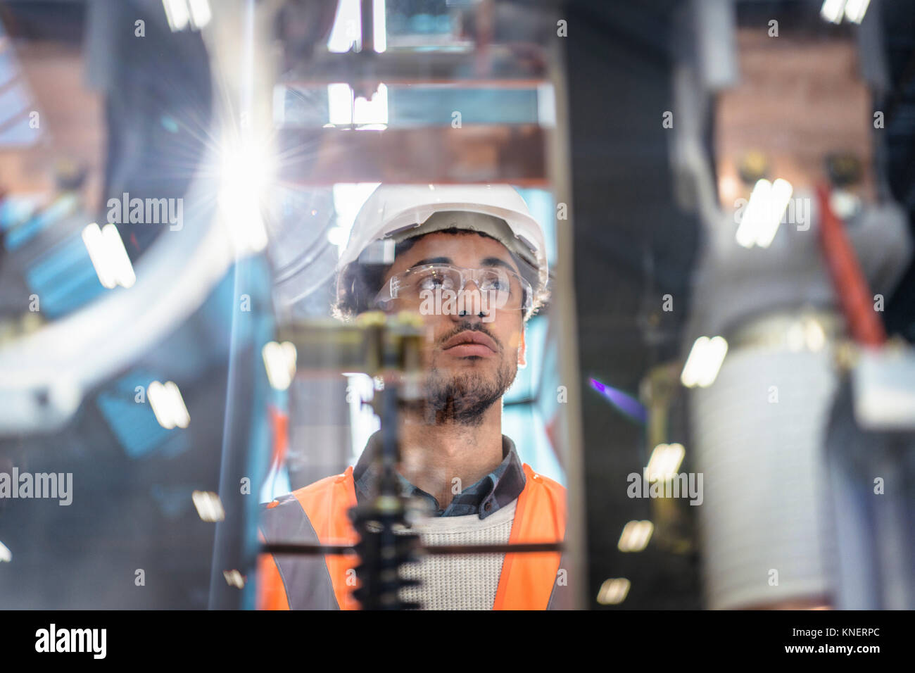Portrait of apprentice in workshop of railway engineering facility - Stock Image