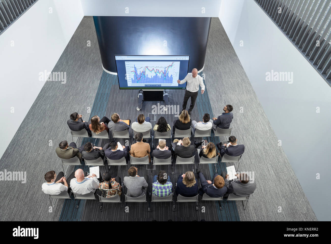 Instructor giving lecture to audience in railway engineering facility - Stock Image