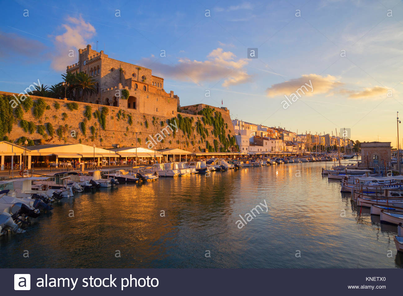 View of historic harbour waterfront and town hall, Ciutadella, Menorca, Balearic Islands, Spain - Stock Image