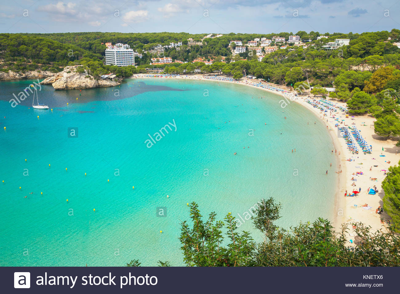 View of holiday makers on sandy beach at Cala Galdana, Menorca, Balearic Islands, Spain - Stock Image