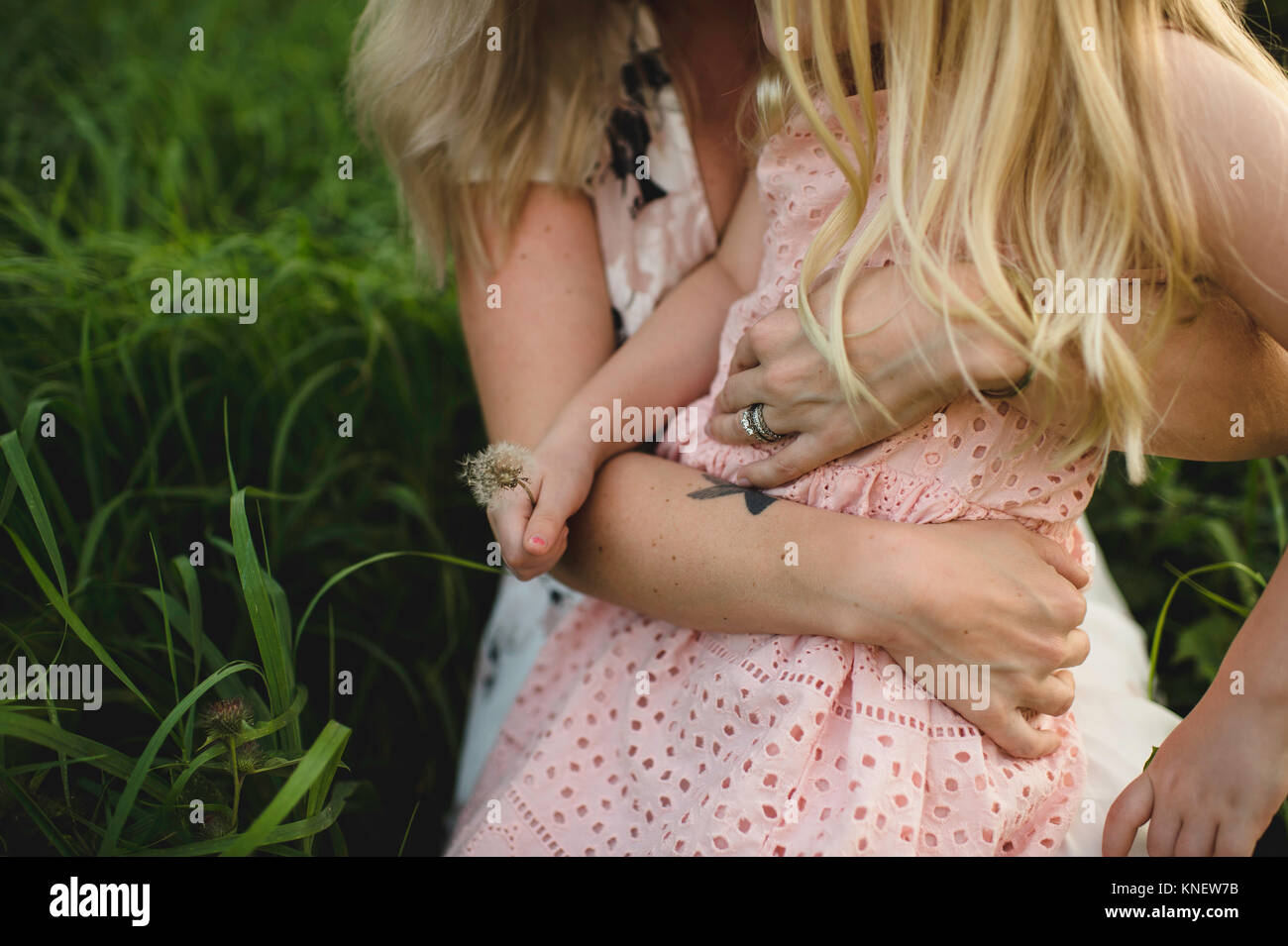 Cropped view of mother and daughter hugging - Stock Image