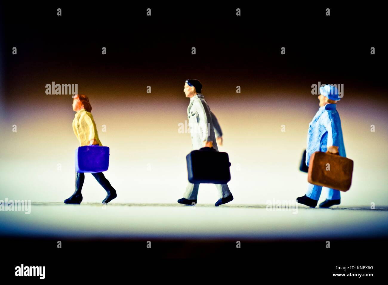 Business, travel. Three travellers walking with their suitcase. - Stock Image