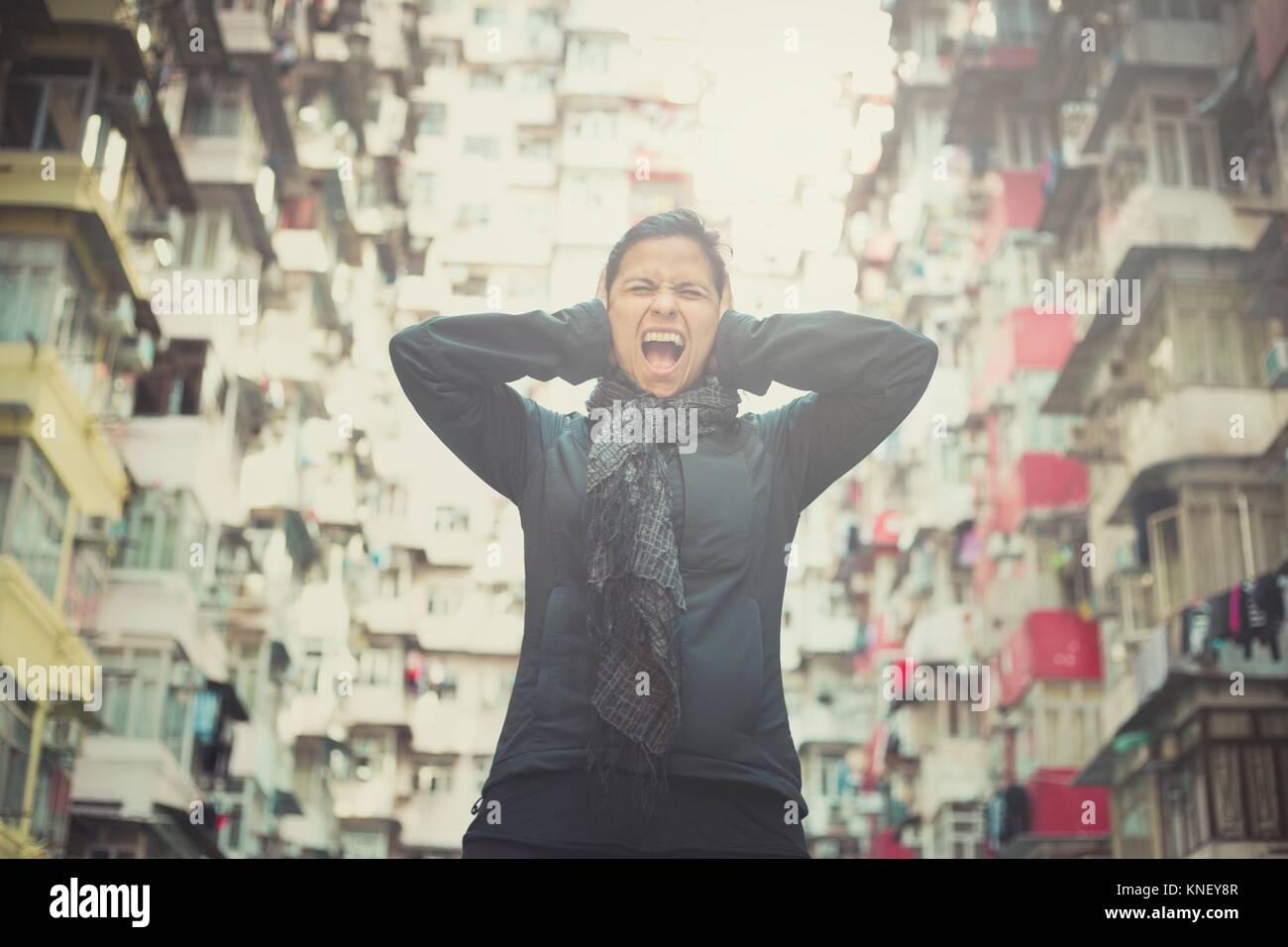Stressed Girl Screaming In Front Of Apartments Yick Cheong Buildings Stock Photo Alamy