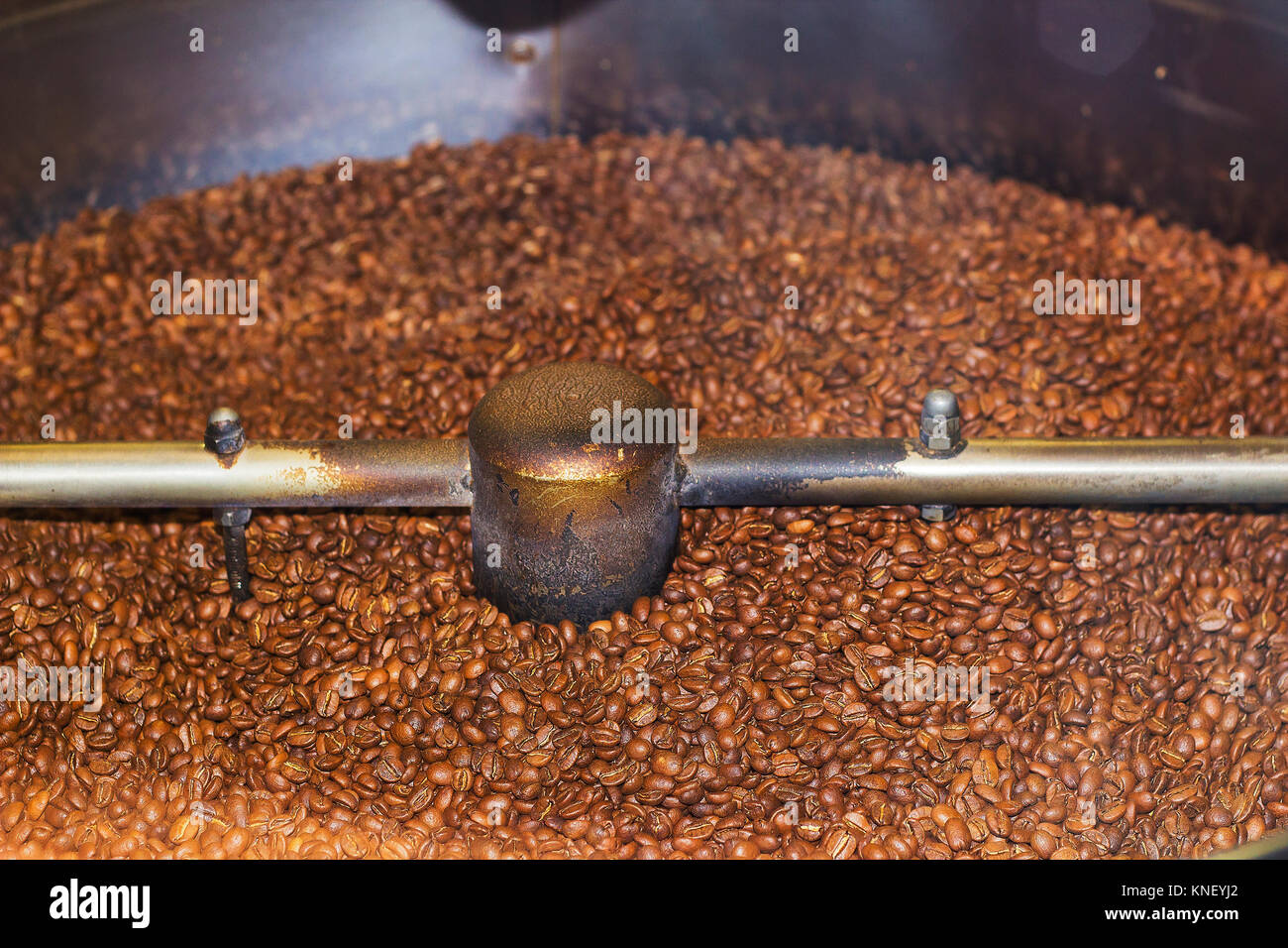 Large coffee mill large grinds coffee beans - Stock Image
