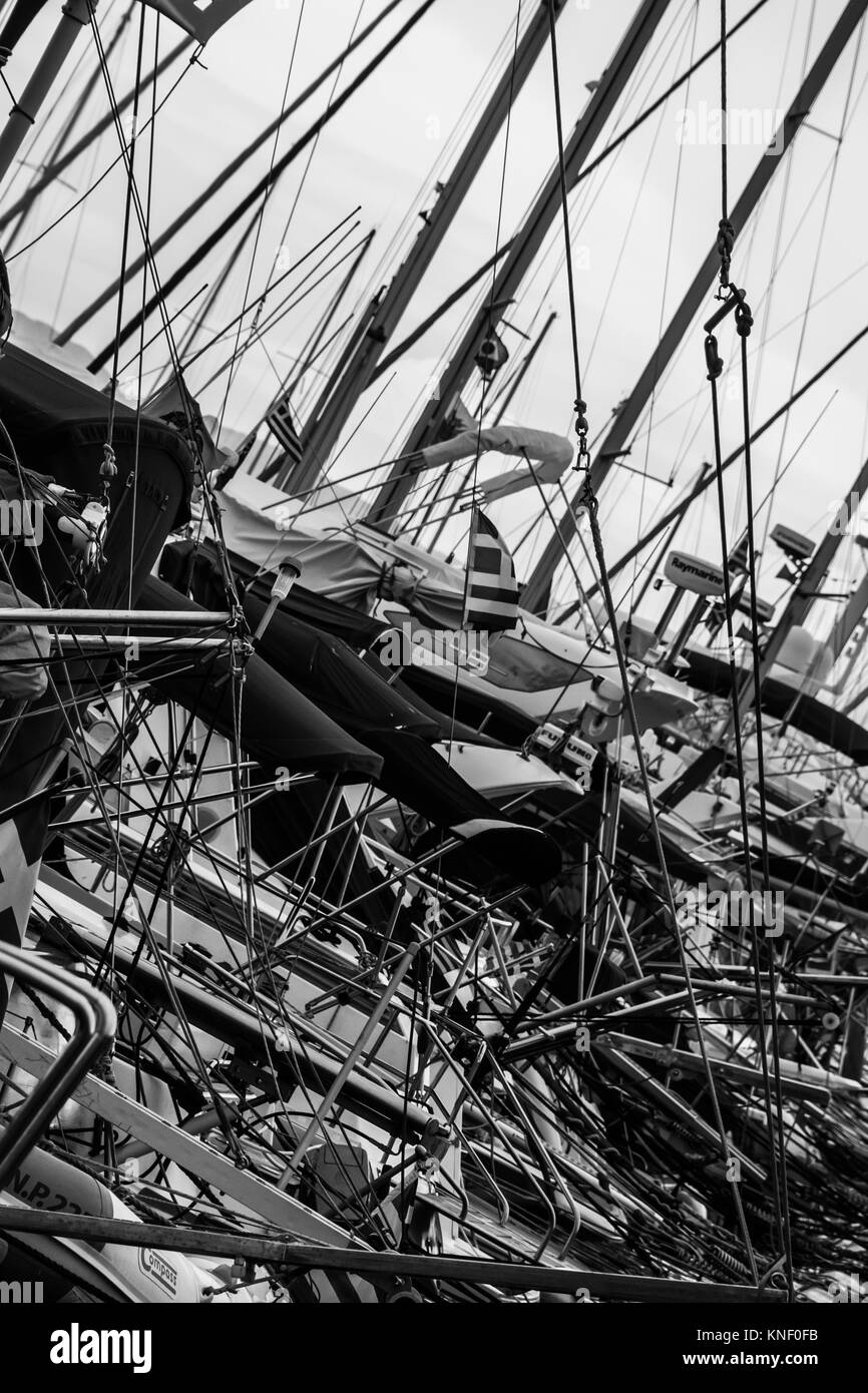 Black and white composition of congested yacht masts in the harbour in Rhodes town. - Stock Image