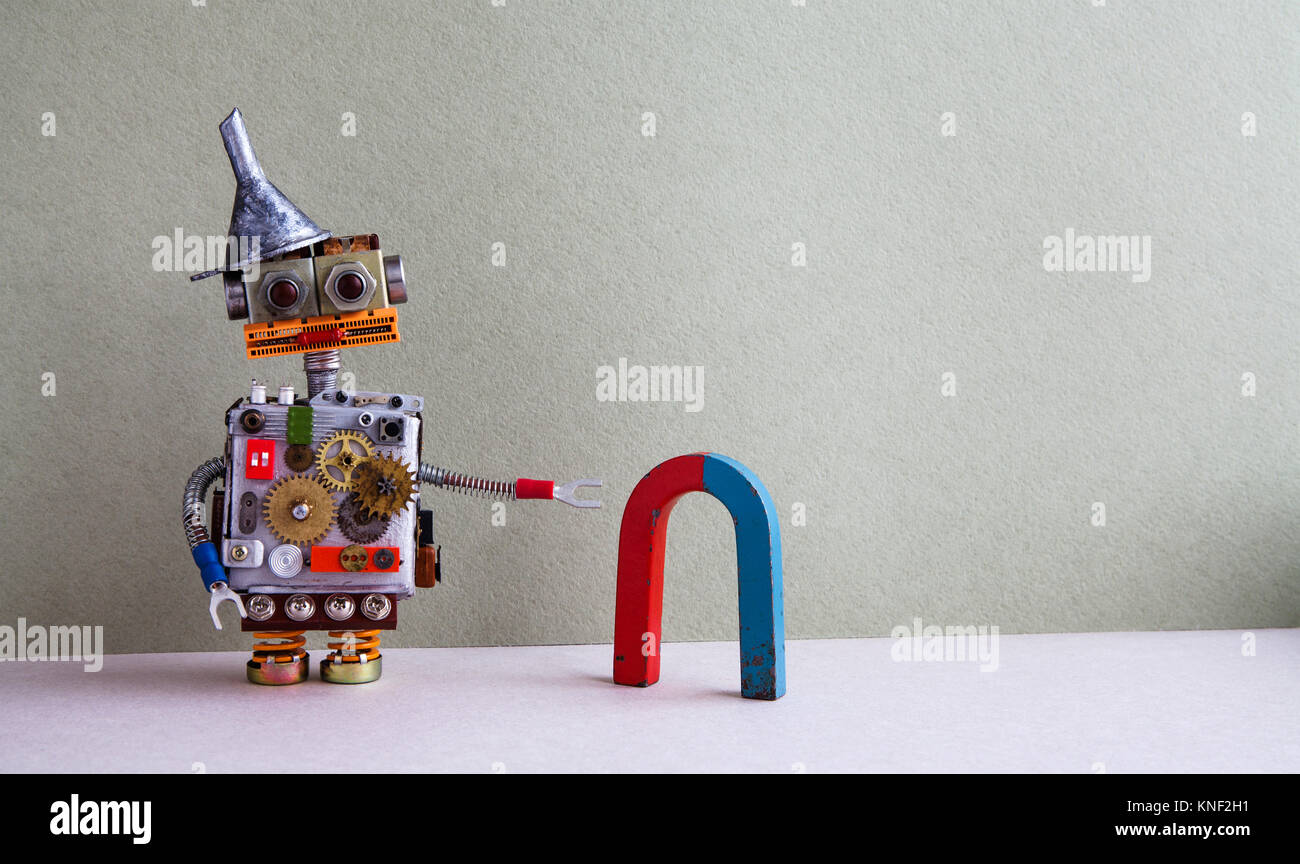 Funny robot red blue horseshoe magnet. Creative design toy with metal funnel hopper, cogs wheels gears silver metallic - Stock Image