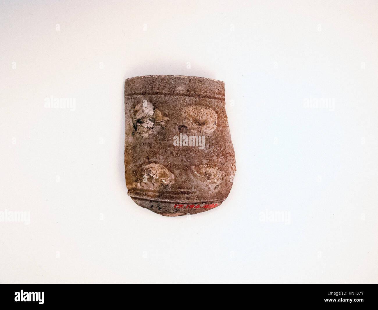 Vase fragment. Culture: Roman; Medium: Terracotta; Dimensions: 2 3/8in. (6cm); Classification: Vases; Credit Line: Stock Photo