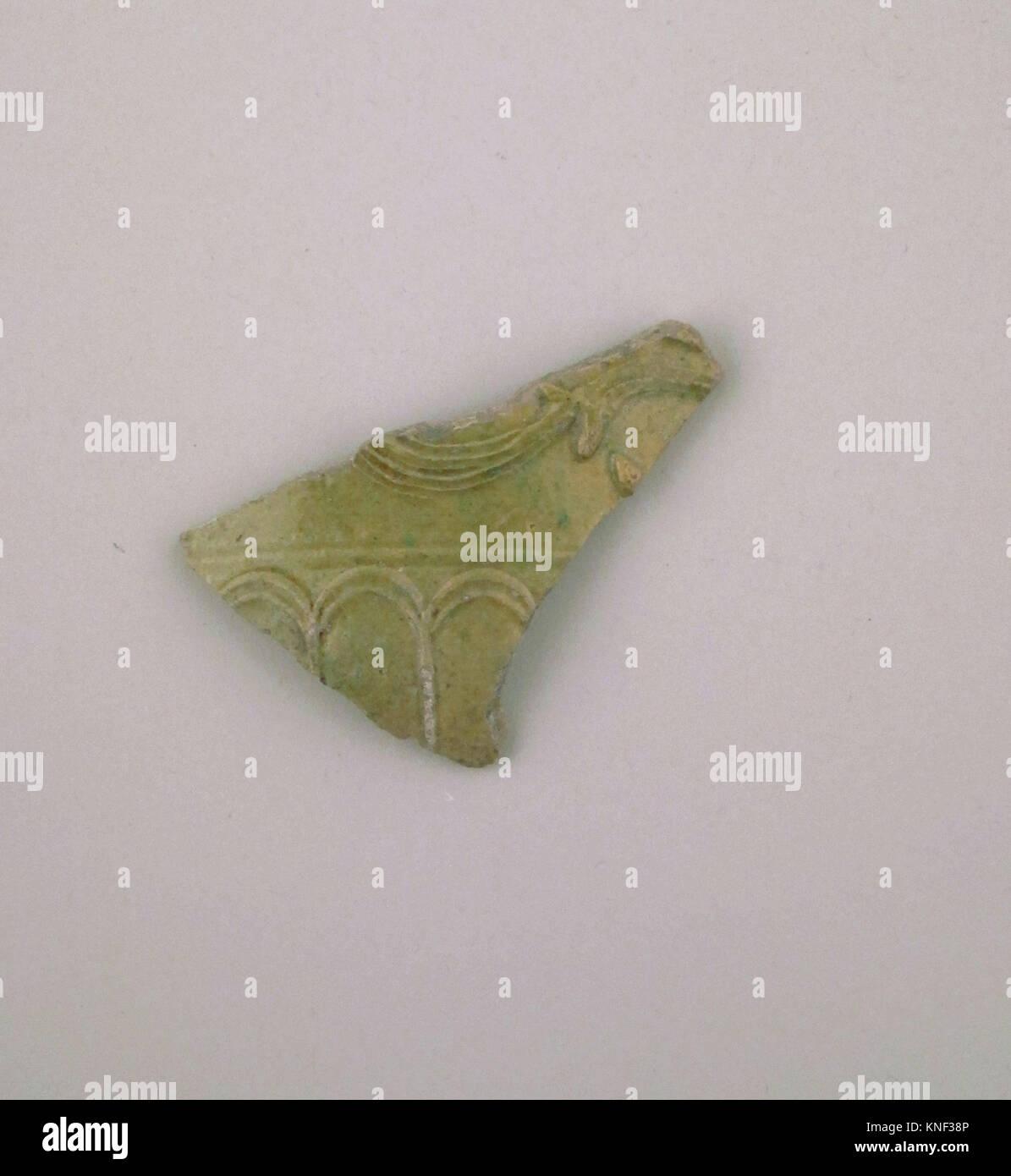 Vase fragment. Culture: Roman; Medium: Terracotta; Dimensions: width 6.60 cm; Classification: Vases; Credit Line: Stock Photo