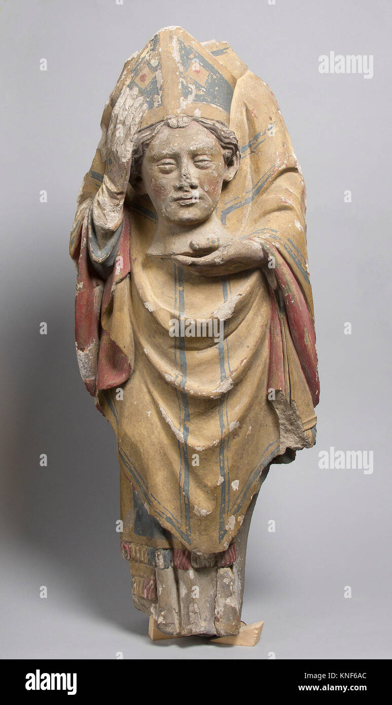 Saint Denis. Date: 14th century; Culture: French; Medium: Stone, paint; Dimensions: Overall: 24 1/2 x 10 1/8 x 5 Stock Photo