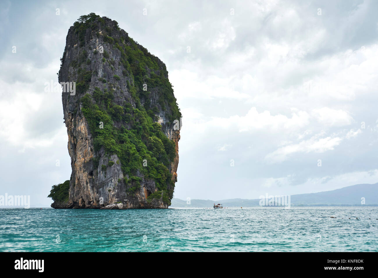 Rock formation protruding from sea, Phuket, Thailand, Asia - Stock Image