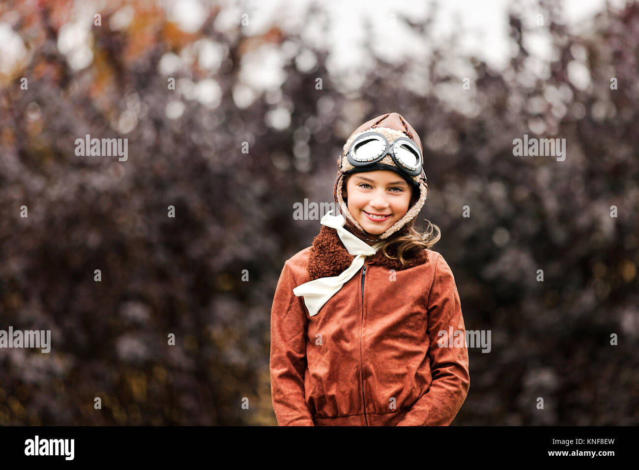 Portrait of girl wearing pilot costume for halloween in park  sc 1 st  Alamy & Portrait of girl wearing pilot costume for halloween in park Stock ...