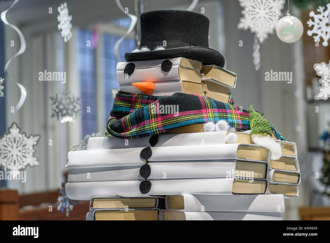 A Christmas snowman decoration made from books in a library , Northwich, Cheshire UK Stock Photo