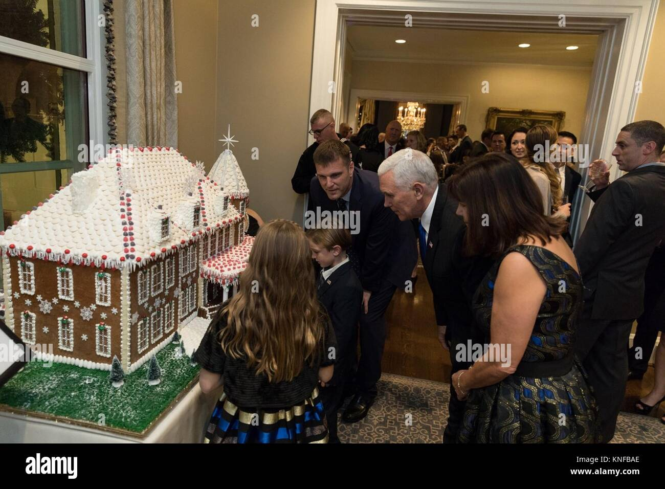 U.S. Vice President Mike Pence and his wife Karen Pence, center, view a gingerbread house with children of United - Stock Image
