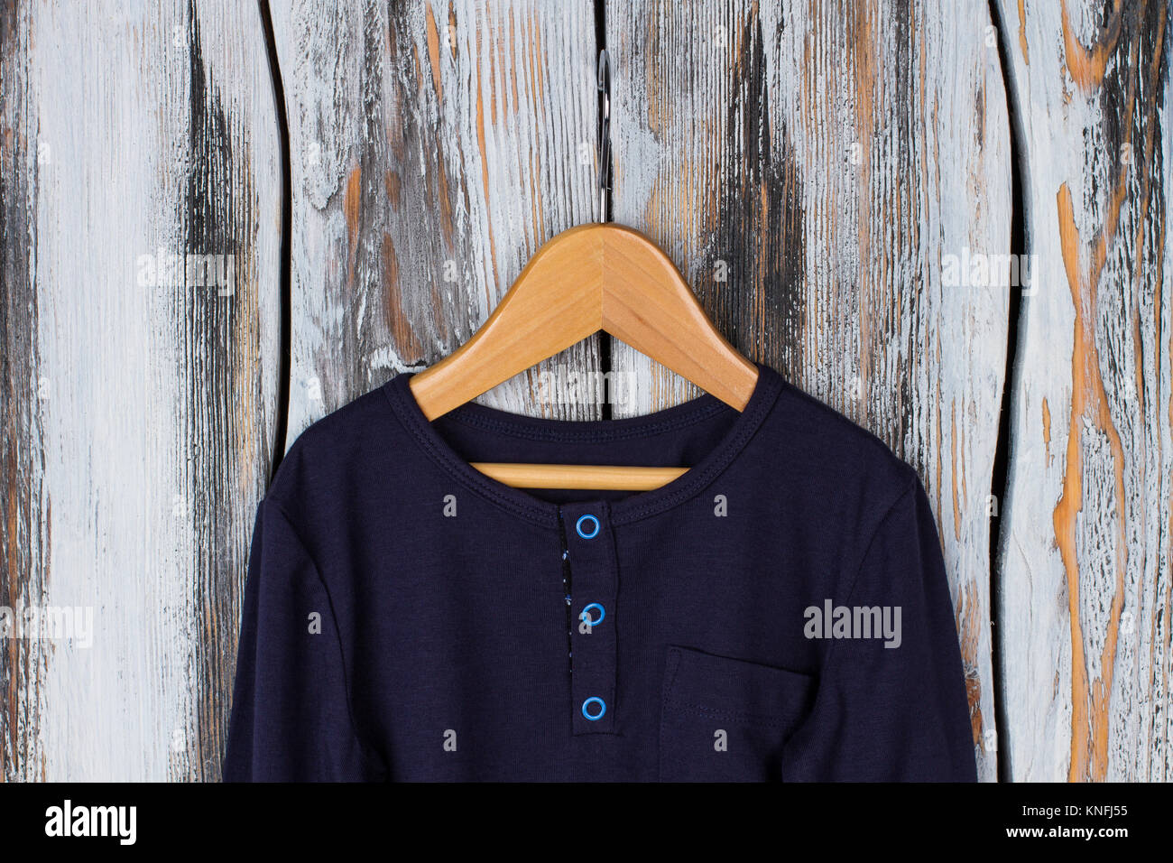 Navy top with blue buttons - Stock Image