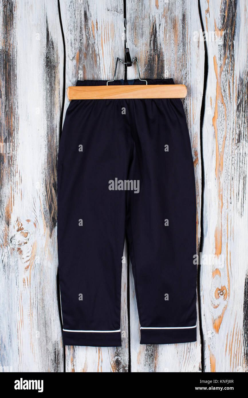Boys sweatpants on a hanger - Stock Image