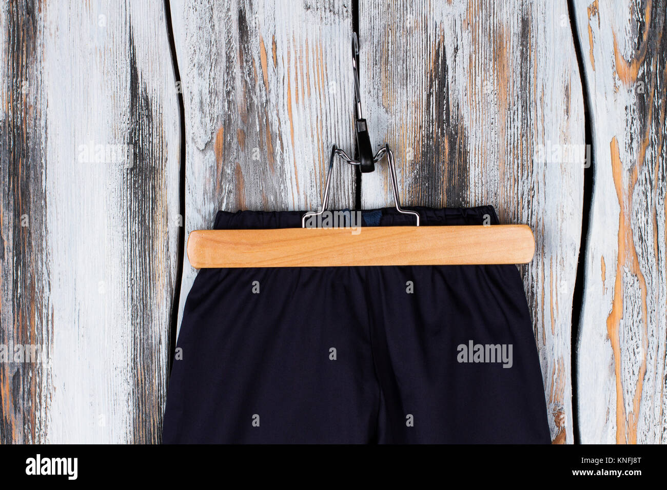 Pants on a wooden hanger - Stock Image