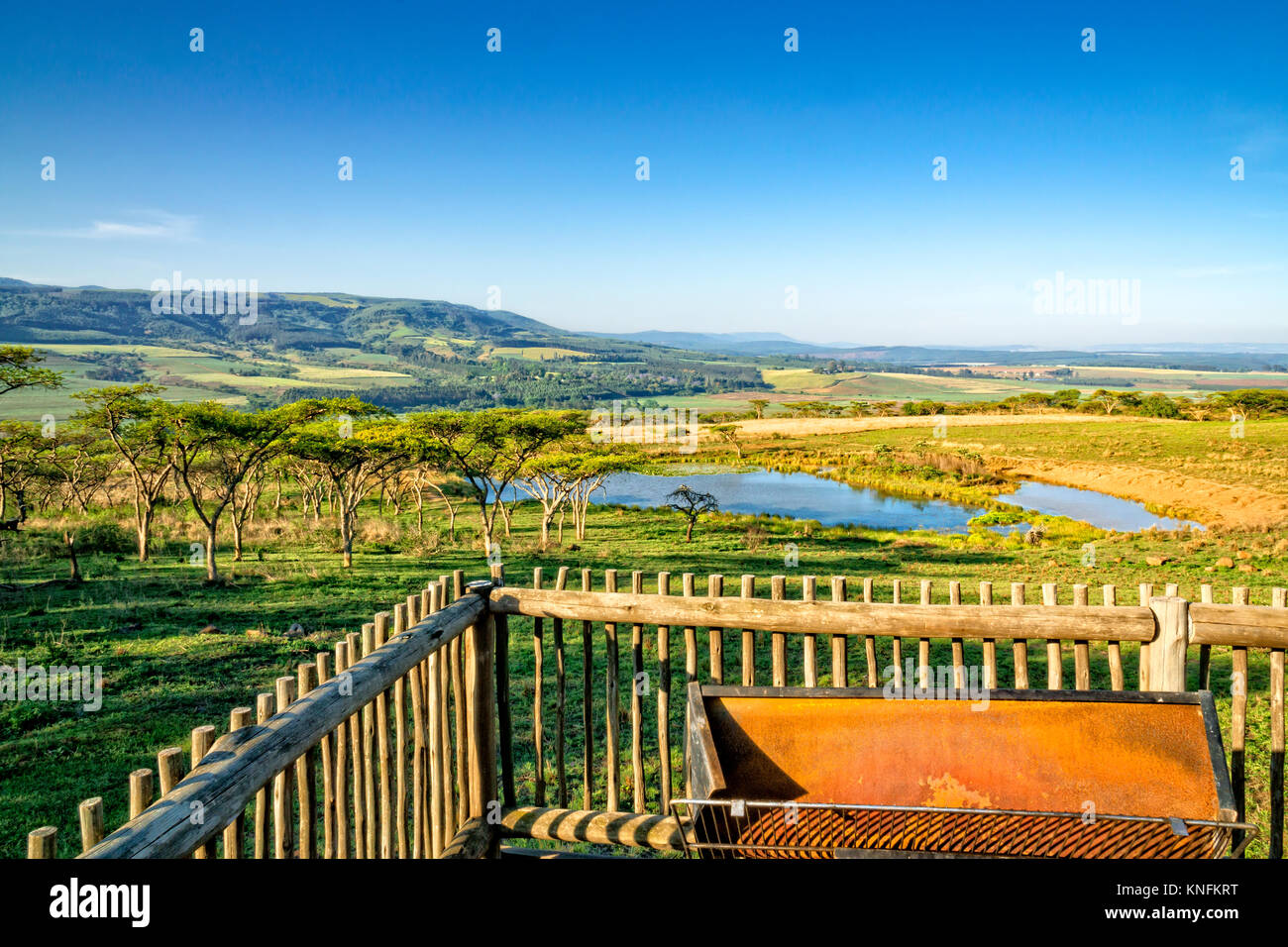 Picturesquely situated lodge in the Drakensberg mountains, South Africa. Photo is taken from the terrace of  the - Stock Image