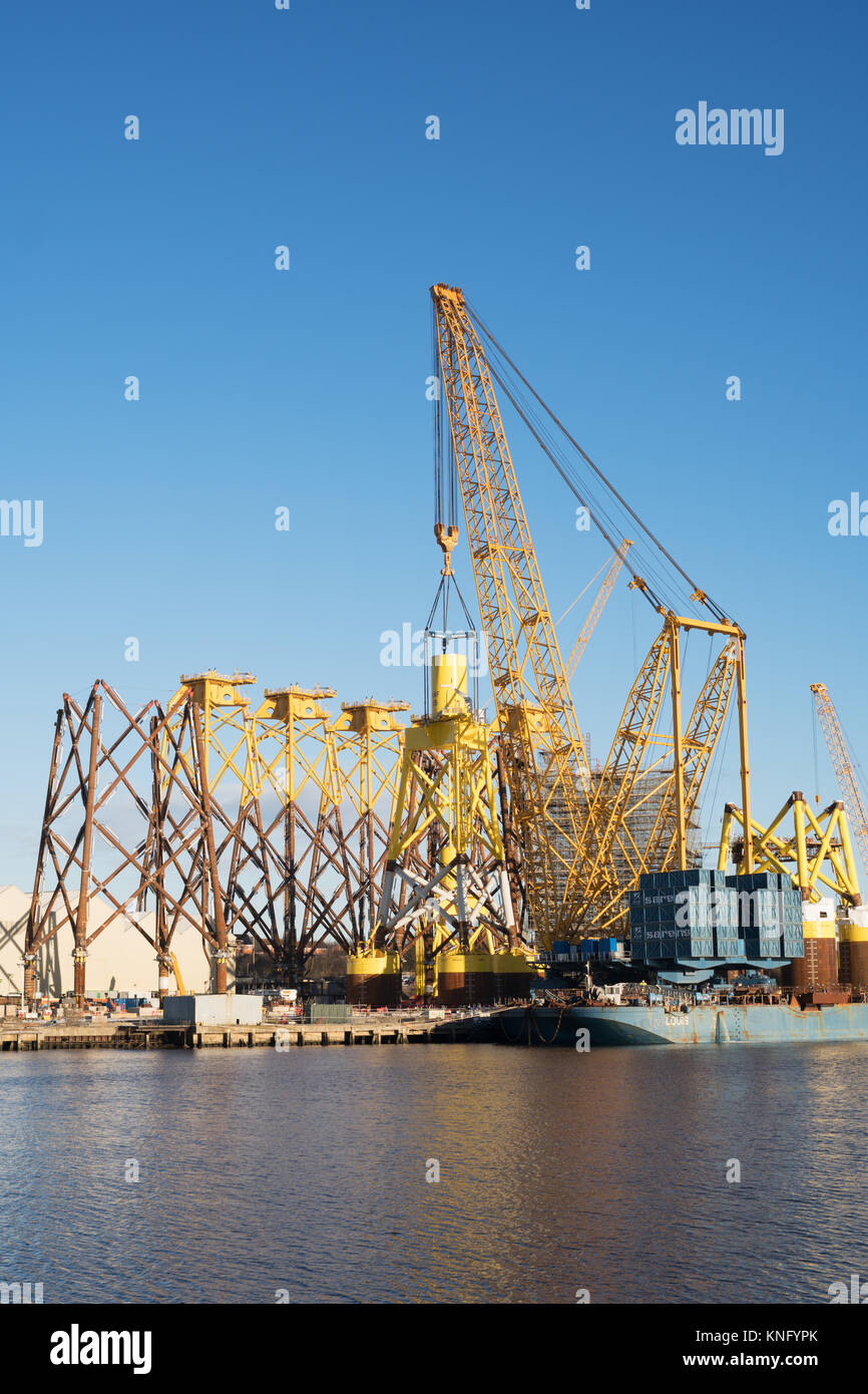 Sarens giant crane lifts offshore wind turbine support at Smulders Hadrian Yard on the Tyne, Wallsend, north east England, UK Stock Photo