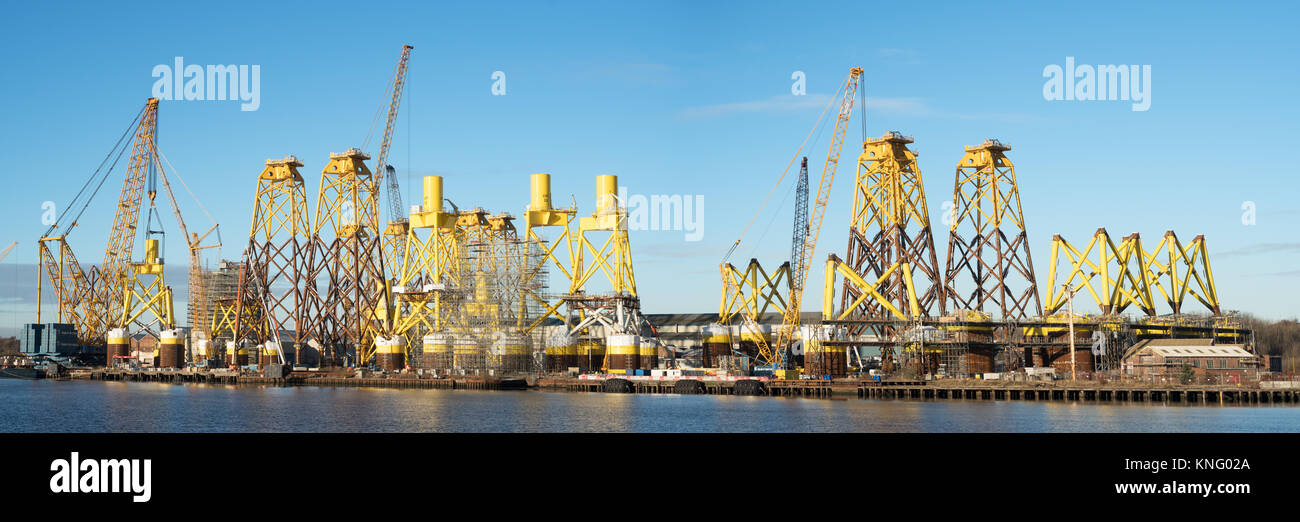 Panoramic view of offshore wind turbine supports being built at Smulders Hadrian Yard on the Tyne, Wallsend, north east England, UK Stock Photo
