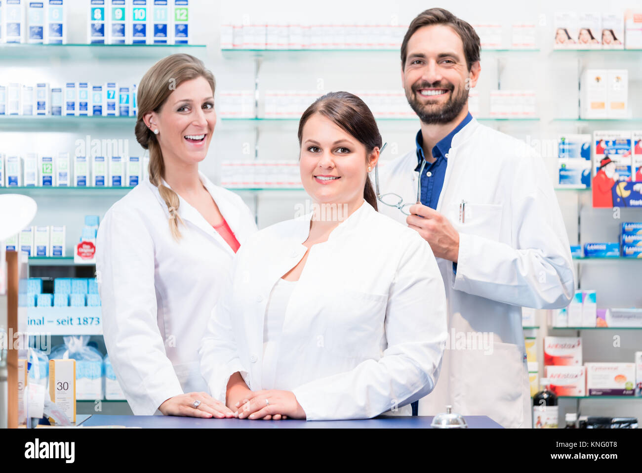 Team of apothecaries in pharmacy - Stock Image