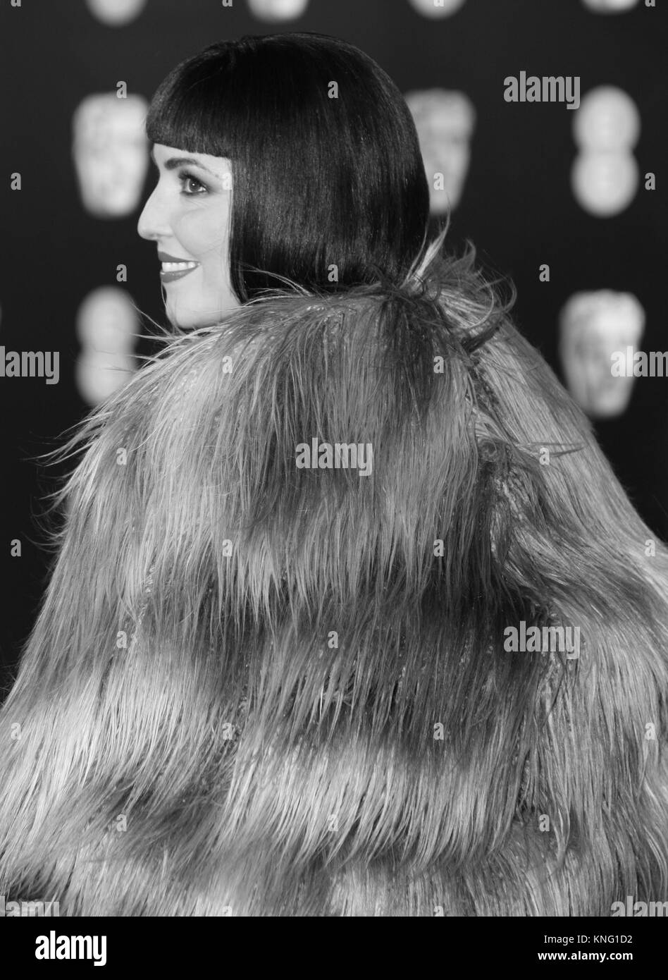 Image digitally altered to monochrome Noomi Rapace attends The EE British Academy Film Awards (BAFTA) at the Royal Stock Photo