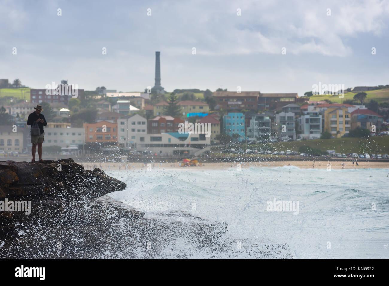 Sea spray from wave hitting rocks off the coastal walk between Bondi and Bronte beaches. Eastern suburbs, Sydney, Stock Photo