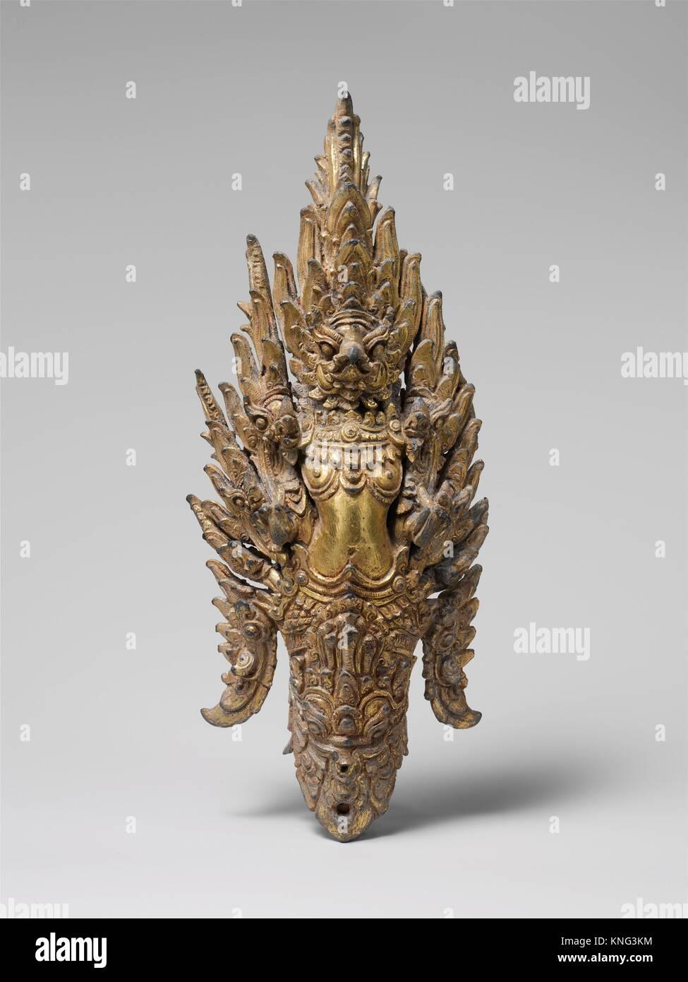 Garuda Finial. Date: late 12th-early 13th century; Culture: Thailand; Medium: Gilt bronze; Dimensions: H. 9 3/4 - Stock Image