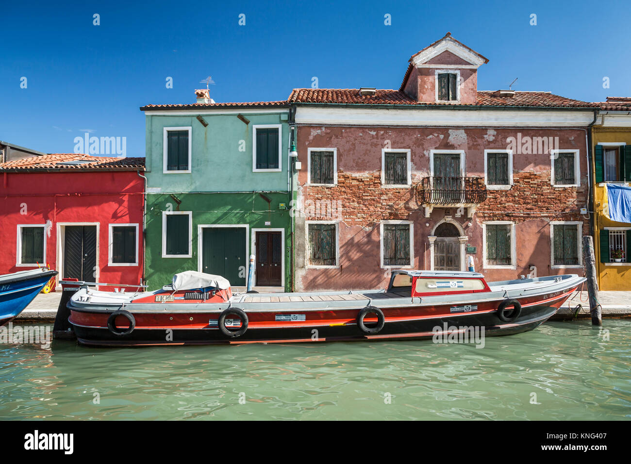 The colorful buildings, canals and boats in the Venetian village of Burano, Venice, Italy, Europe. - Stock Image