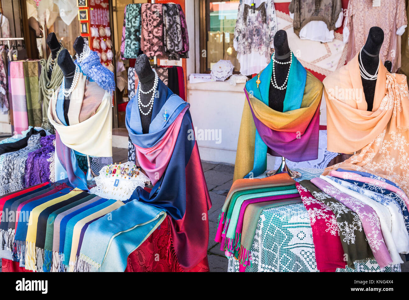A lace shop display in the Venetian village of Burano, Venice, Italy, Europe. - Stock Image