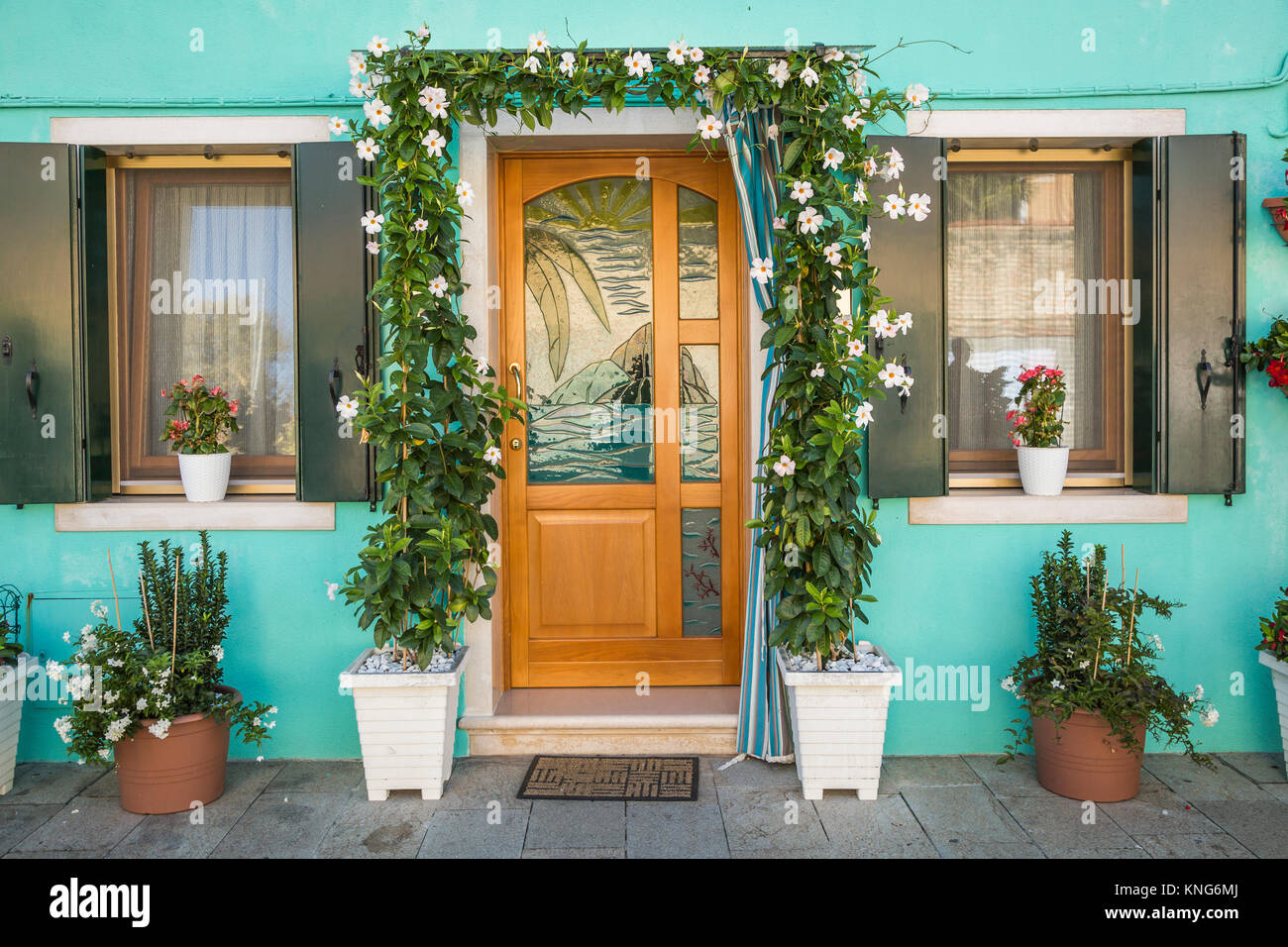 A colorful building front entrance in the Venetian vlllage of Burano, Venice, Italy, Europe. - Stock Image