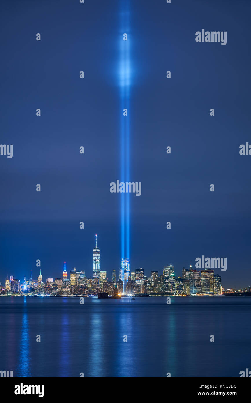 New York City skyline with skyscrapers and the two beams of the Tribute in Light. Lower Manhattan, Financial District, - Stock Image