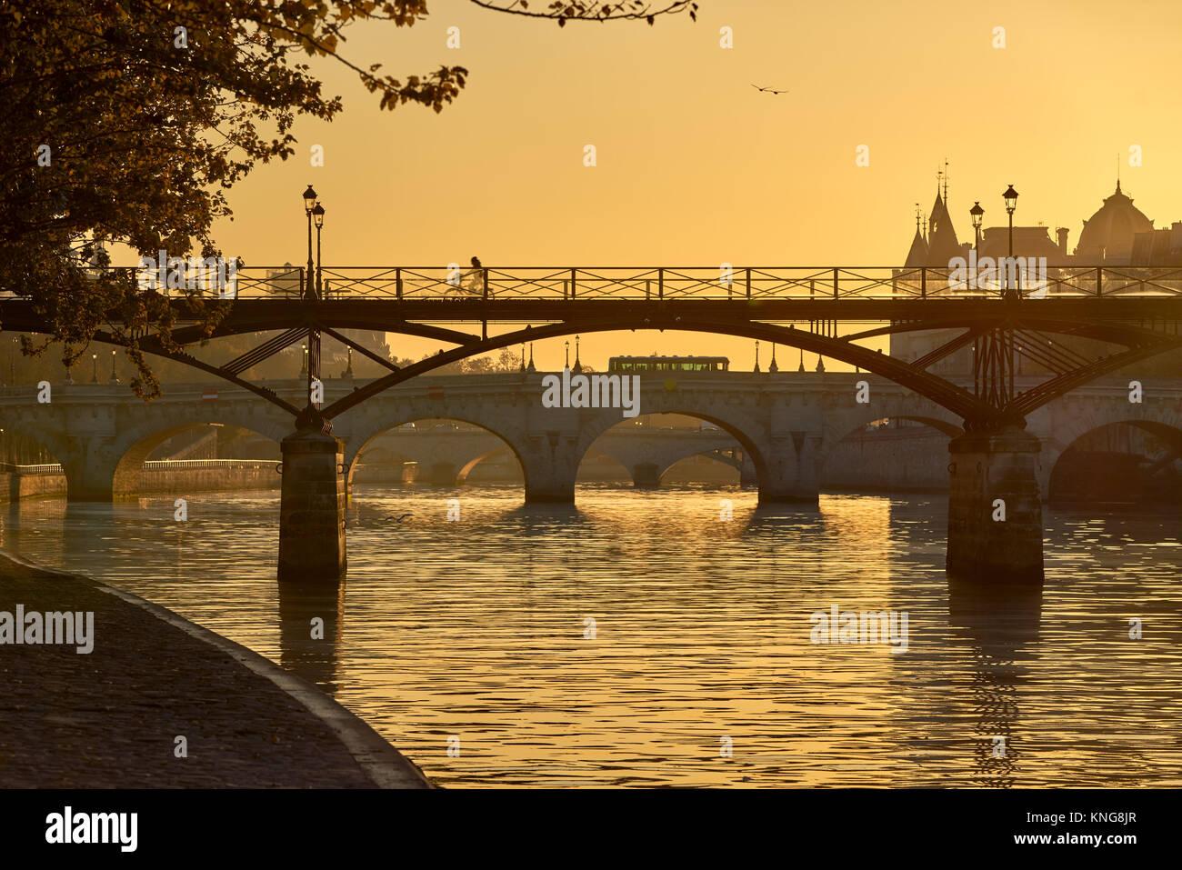 Sunrise over the Pont des Arts, Pont Neuf and the Seine River banks. Ile de la Cite, 1st Arrondissement, Paris, - Stock Image