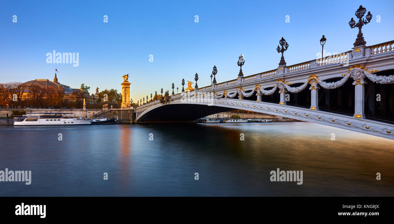 Pont Alexandre III bridge and Seine River at sunset (panoramic). 8th Arrondissement, Paris, France - Stock Image